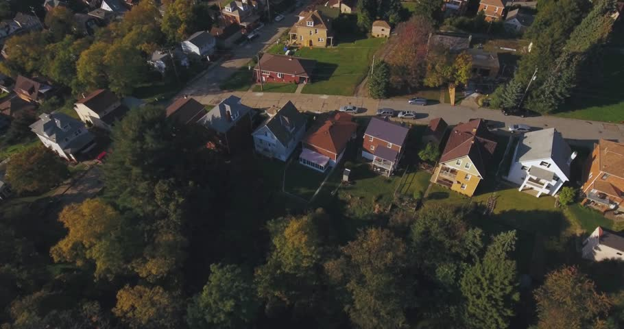 An aerial view above a small Western Pennsylvania town and residential neighborhood on an Autumn evening. Pittsburgh suburb.	 	 | Shutterstock HD Video #20532931