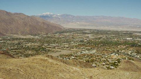 Aerial USA America California Coachella Valley Palm Springs city Desert Oasis Residential outdoor tropical Wind Farm Turbines Hills