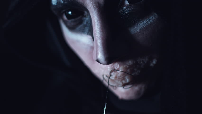 4k Halloween and Horror Woman Alien Sewing her Mouth | Shutterstock HD Video #20573251