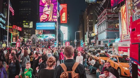 NEW YORK CITY - OCTOBER 07 (TIMELAPSE): Hyperlapse walk through crowd of tourist around Times Square in the evening time on October 07, 2016 in New York, USA.