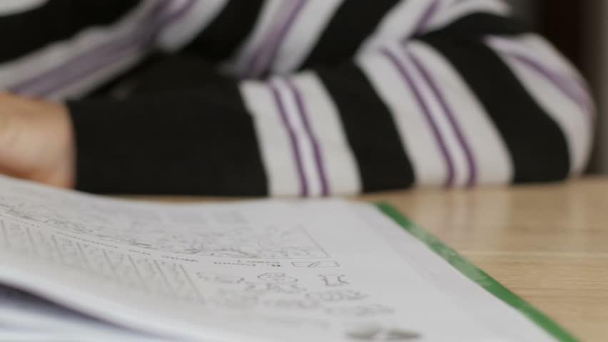 Boy reads a book in English | Shutterstock HD Video #20638609