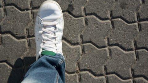 Upside down POV video â?? walking in old white sneakers in slowmo 50 fps