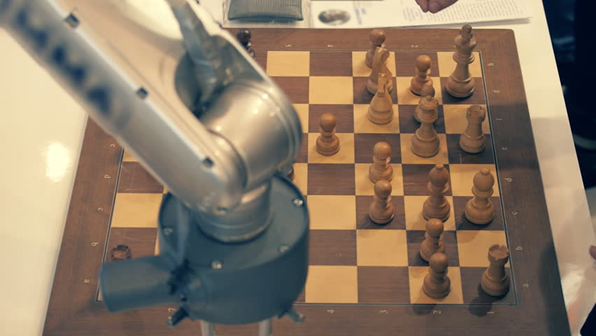 Robot playing chess with a man. Hand manipulator moves the chess and presses the key of the control watch | Shutterstock HD Video #20680111