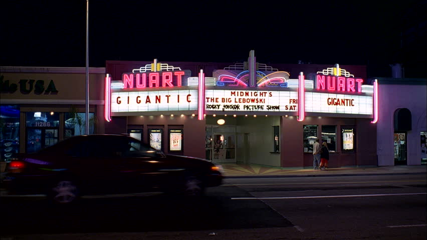 night Wide Static Raked left small town Nuart theate right, playhouse independant movie small concert venue, neon lights Gigantic other movies listed marquee Quiet