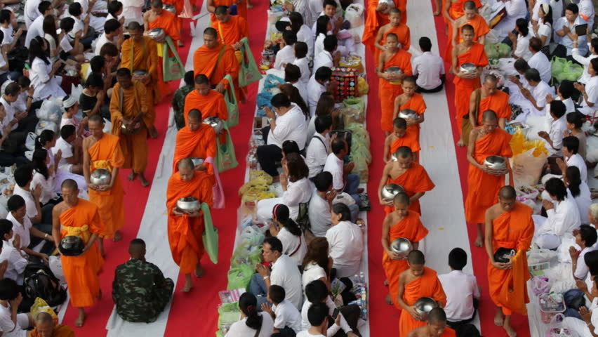 BANGKOK - MARCH 17: Monks are participating in a Mass Alms Giving of 12,600 monks in Saphan Khwai for the Makha Bucha celebrations on March 17, 2012 in Bangkok, Thailand.