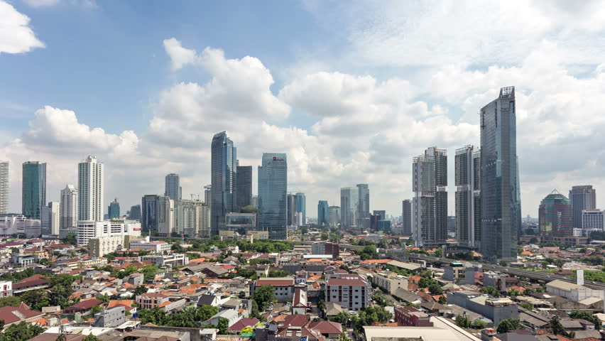 Time lapse of clouds moving above the business district between Kuningan and Sudirman in downtown Jakarta, Indonesia capital city on the Java island. Jakarta is South East Asia largest city.