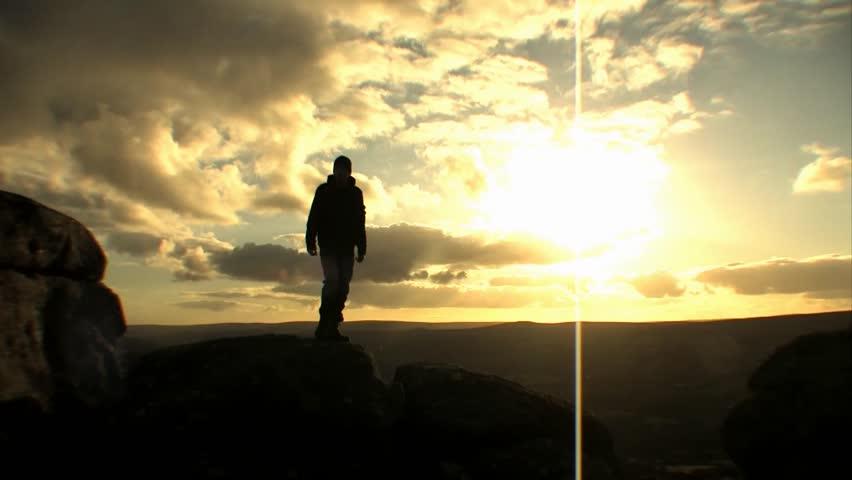 Figure Jumping Off Rocks - Silhouette Sunset | Shutterstock HD Video #2077715