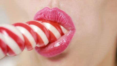 sexy girl eating a lollipop. simulation of oral sex. tongue licking candy