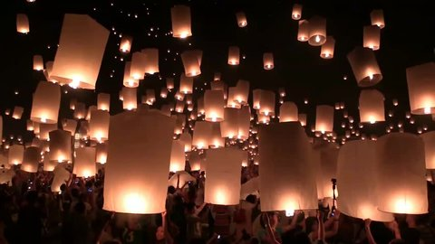 Amazing Yee Peng and Loy Krathong Festival of Floating Lights and Sky lanterns at Mae Jo, Chiang Mai, Thailand. Slow Motion.
