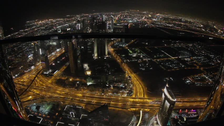 panoramic view from the top to the night lights and traffic flow on flyover in Dubai, UAE