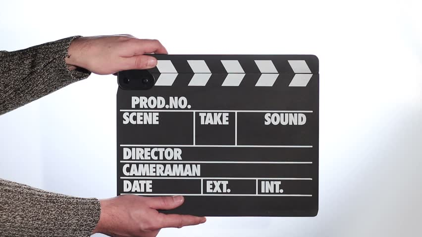 Close up of male hand holding movie clapperboard