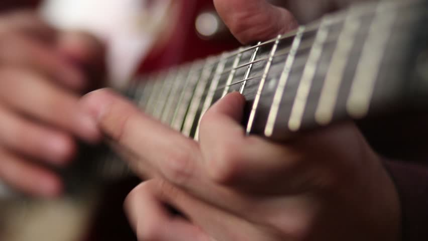 Guitar player using tapping technique