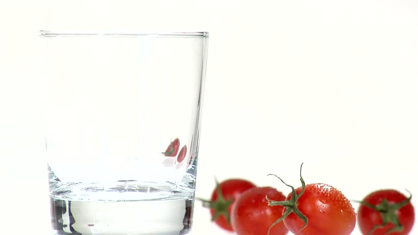 Pouring tomato juice into a glass