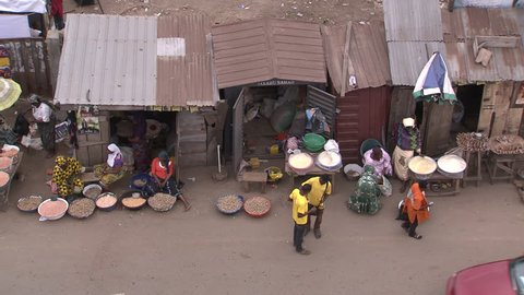 Osogbo, Nigeria - August 2013; High angle view of market stalls and passing traffic