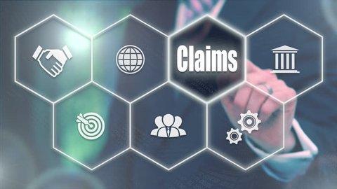 Businessman pressing a Business Claims concept