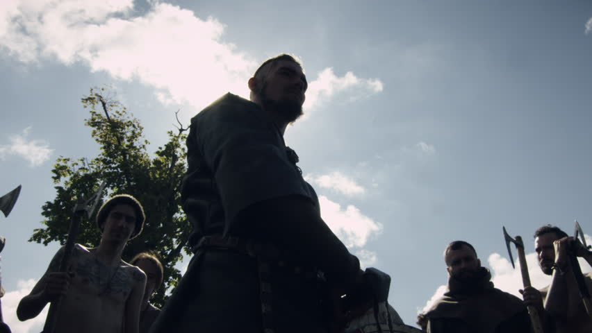WOLIN, POLAND - 06.08.2016: Army Leader Inspires his Warriors with Battle Speech and Raises Sword during Slavs and Vikings Festival. Medieval Reenactment. Shot on RED Cinema Camera in 4K (UHD).