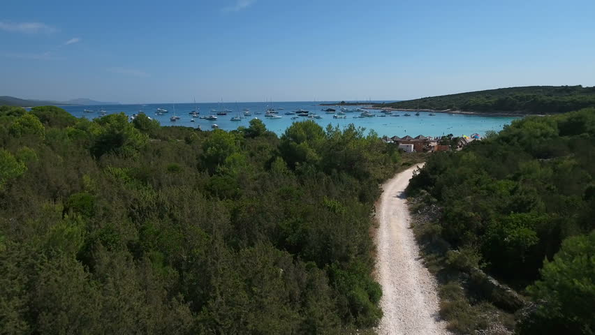 Aerial - Flying above gravel trail leading to the famous beach Sakarun on Dugi Otok | Shutterstock HD Video #20978281