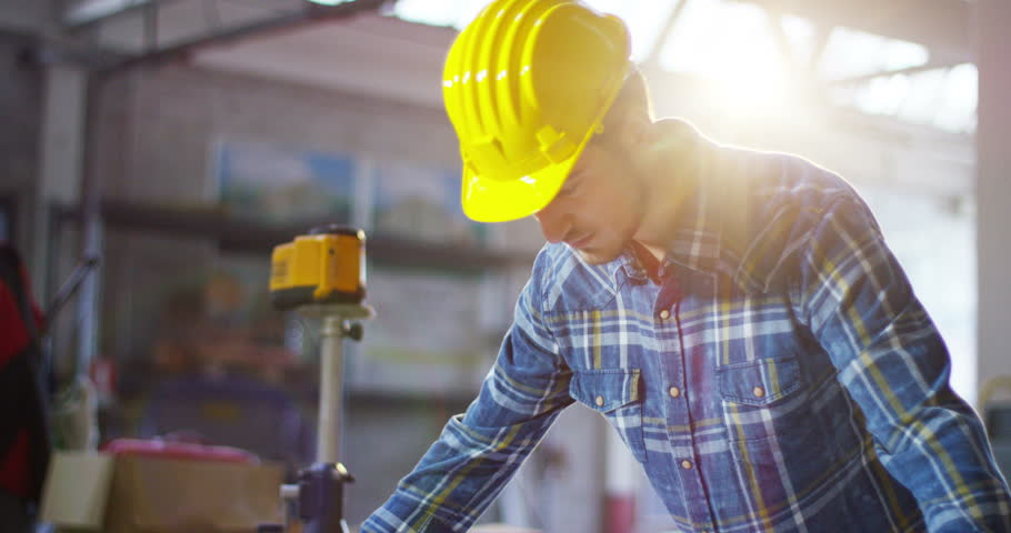 on a construction site, a worker or an engineer or architect controls the design and construction of the building with high energy savings. Concept: construction, worker, engineering, design.