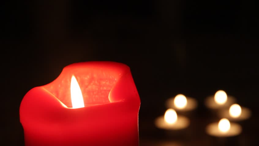 Red burning candle in the dark  | Shutterstock HD Video #20991301