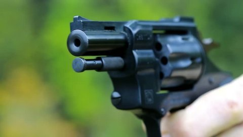Man Shoots a Revolver  Soldier Stock Footage Video (100% Royalty-free)  20994721 | Shutterstock