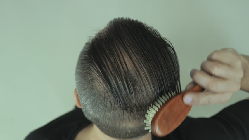Stock video of comb over. close-up of man using | 21006421 ...