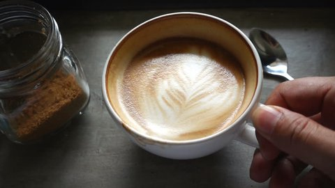 Top view of coffee latte, slow motion
