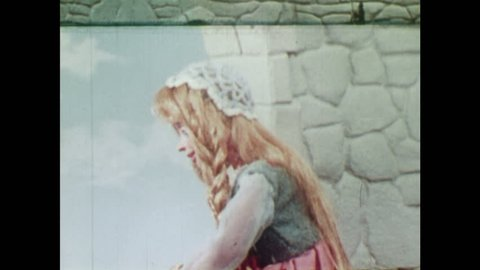 ANIMATED 1950s: Rapunzel falls in love with young man. Witch comes to visit Rapunzel and climbs through window. Witch gets angry.