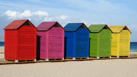 Colorful wooden huts on the beach of San Juan, Alicante, Spain. Filmed in November 2016.