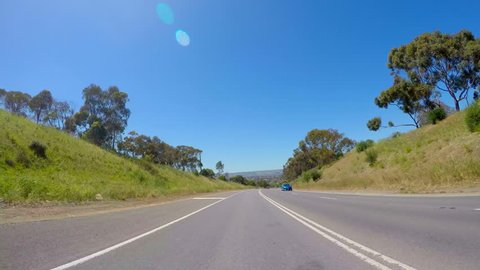Australian country road vehicle POV, driving along highway freeway with views of McLaren Vale, South Australia, in the distance.