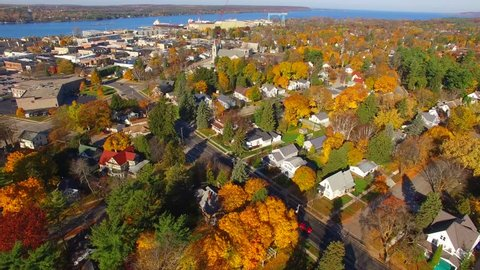 Colorful Autumn aerial flyover of scenic small town America.