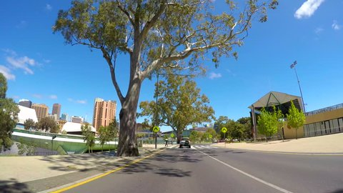 ADELAIDE, SOUTH AUSTRALIA - NOVEMBER 6, 2016: Vehicle POV, driving along the scenic War Memorial Drive, along the banks of the Torrens River past the Adelaide Oval with views of Adelaide city.