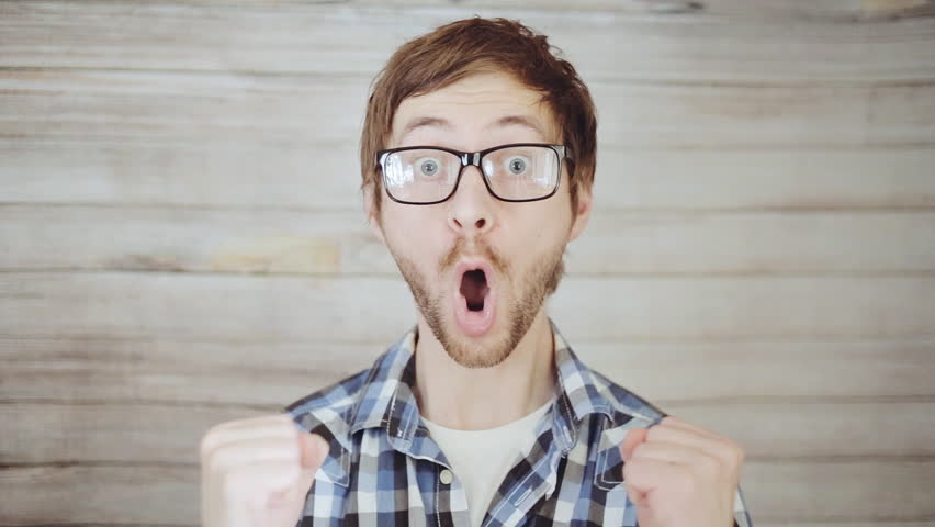 Closeup portrait of happy young man looking surprised. Positive human emotion | Shutterstock HD Video #21147205