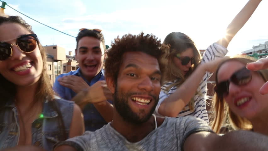 Close up of happy crazy multi-ethnic group of friends filming themselves at rooftop party on sunny day   Shutterstock HD Video #21176410