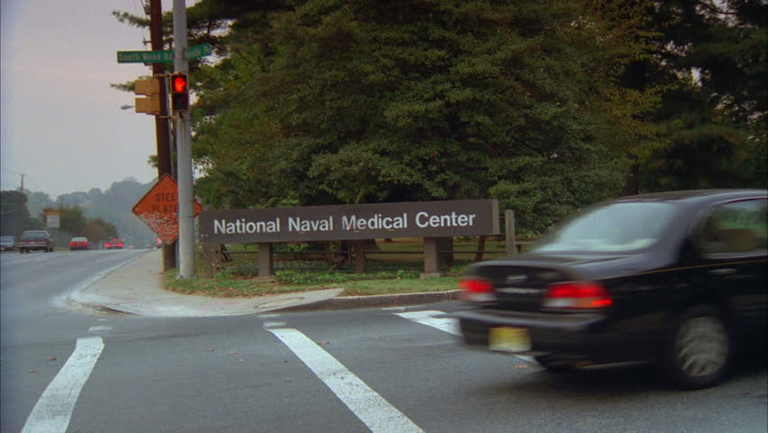 day National Naval Medical Center sign corner wide LS white large stone hospital Bethesda Naval Hospital now known Walter Reed National Military Medical Center