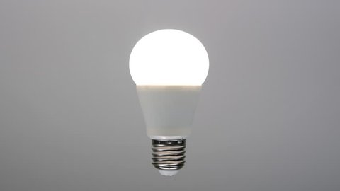 Led bulb turning on, energy saving lamp with e27 socket