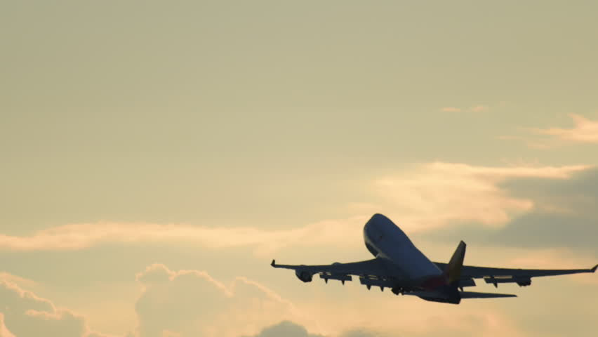4-engine jet airplane take-off against cloudy sunset sky | Shutterstock Video #21221026