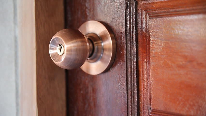 Menu0027s Hand Opens And Closes The Brass Door Knobs   HD Stock Video Clip