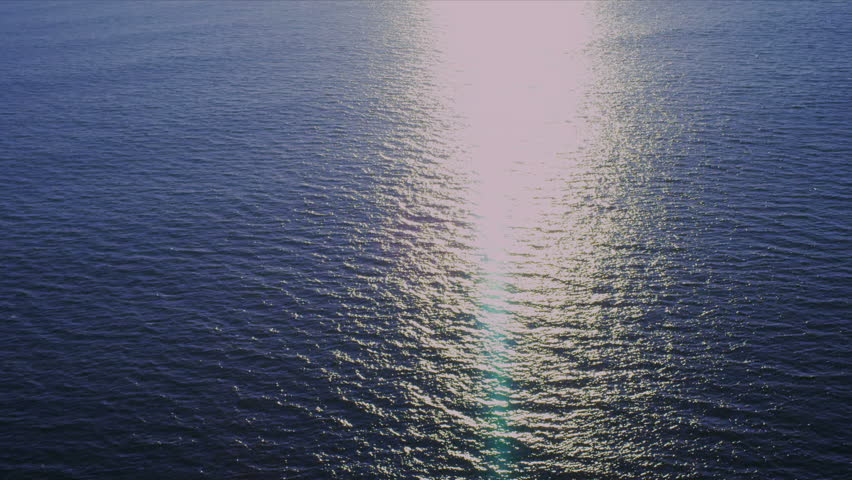 Aerial ocean view of sunlight reflecting on water, USA