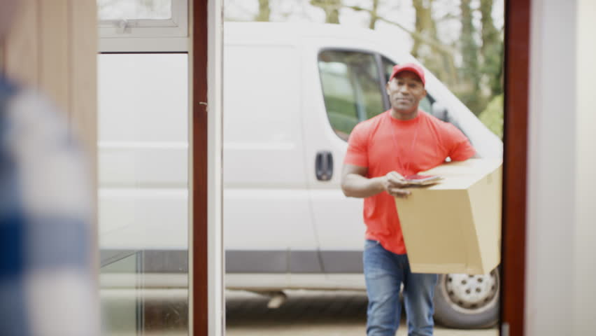4K Friendly delivery driver bringing package to customer\u0027s door \u0026 getting electronic signature. Shot on  sc 1 st  Shutterstock & 4K Friendly Delivery Driver Bringing Package To Customer\u0027s Door ...