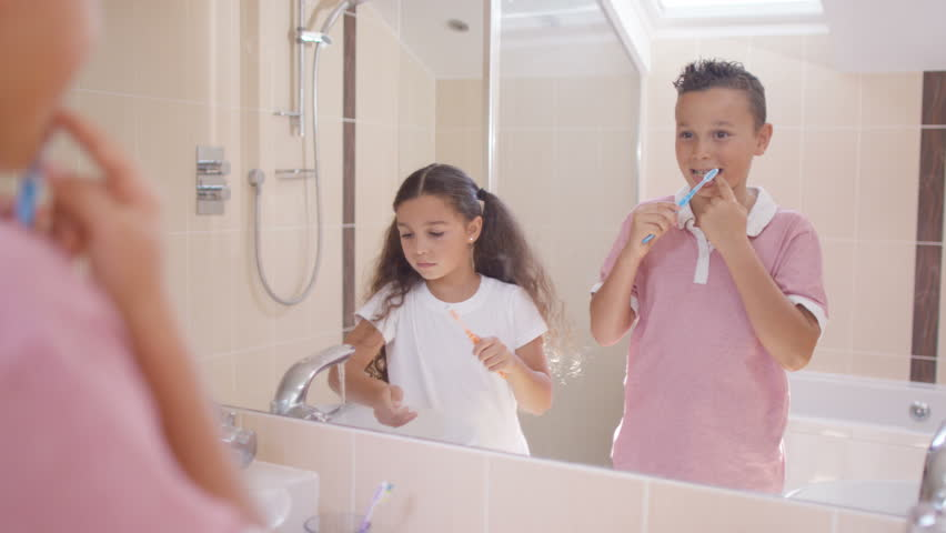 4K Little Girl In Bathroom Cleaning Her Teeth, As Seen From The Mirroru0027s  Pov.