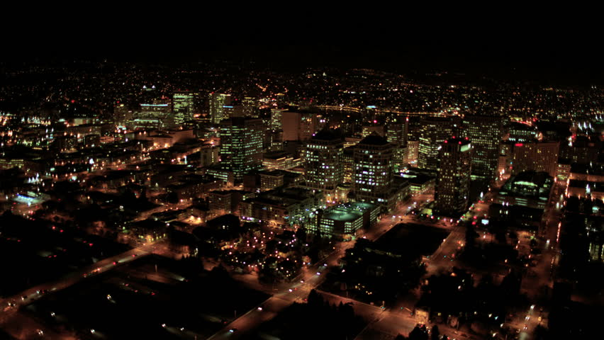 Aerial night illuminated cityscape view of rolling city streets modern buildings North America #2128898