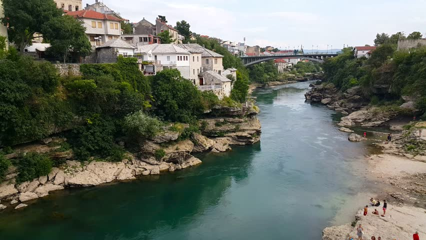 View from the Stari Mostar, the old bridge overlooking the Neretva river in Mostar. | Shutterstock HD Video #21297181