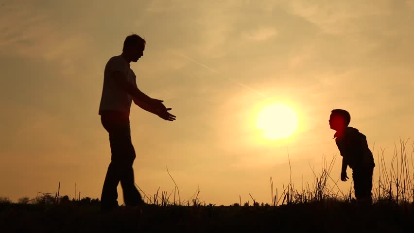 Father and son having fun silhouetted  | Shutterstock HD Video #2129954