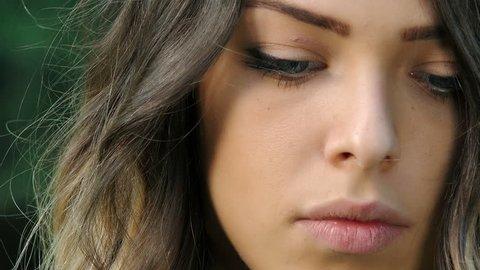 portrait of sad and pensive beautifull woman looking at camera
