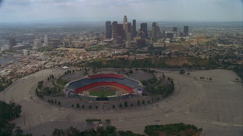 day Aerial forward over empty Dodger Stadium, Los Angeles city background , Los Angeles Landmark