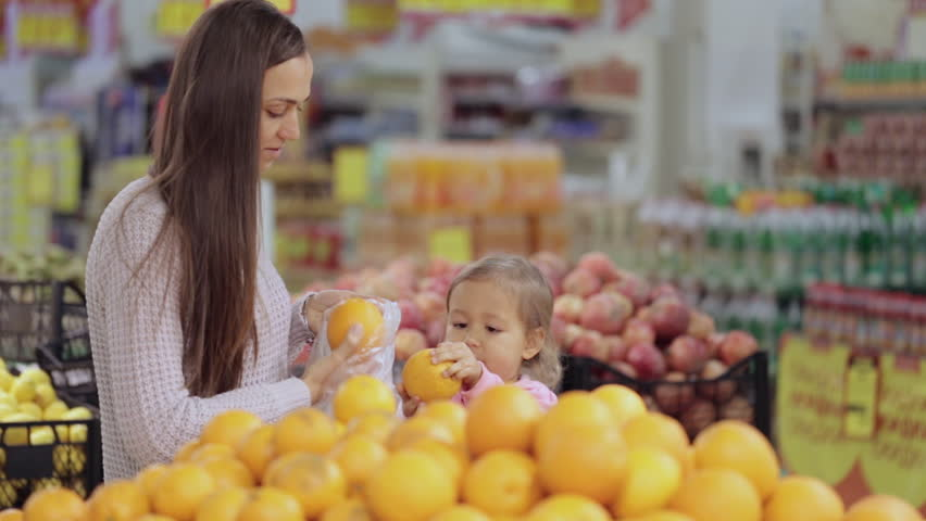 Young mother and cute baby daughter in supermarket buying fruits and vegetables | Shutterstock HD Video #21407707
