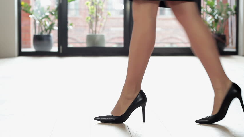 Woman Putting On Black High Heels And Walk Close Up Stock