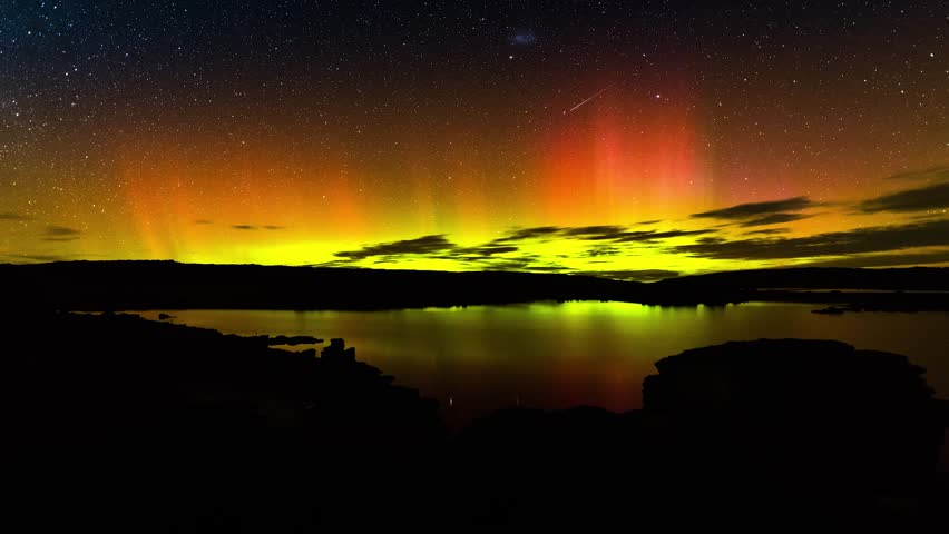 Aurora Australis over lake in Central Otago, New Zealand