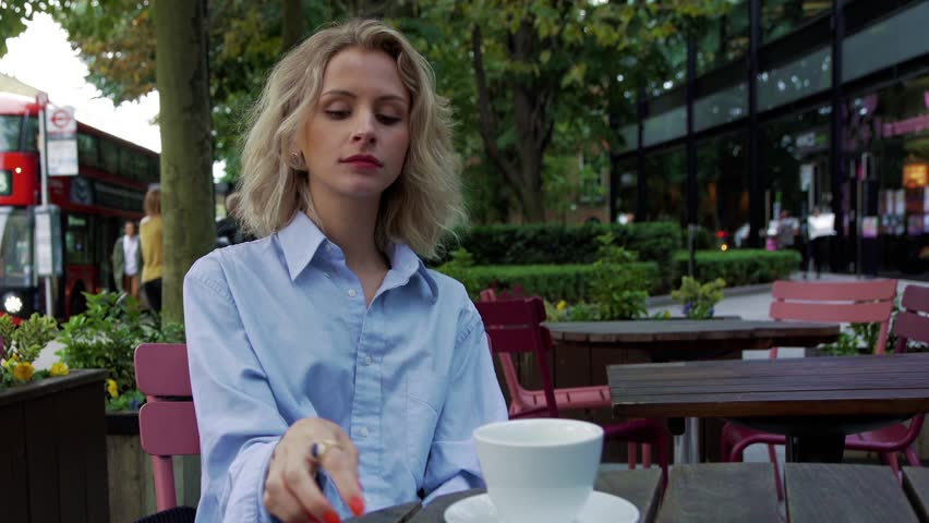 Blonde girl receives a text and becomes concerned  | Shutterstock HD Video #21460291