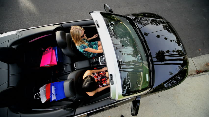 Girls driving off in luxury sports car with designer shopping bags from Rodeo Drive  | Shutterstock HD Video #2151569